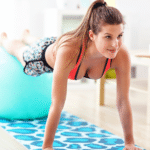 Girl carrying out personal training at home do