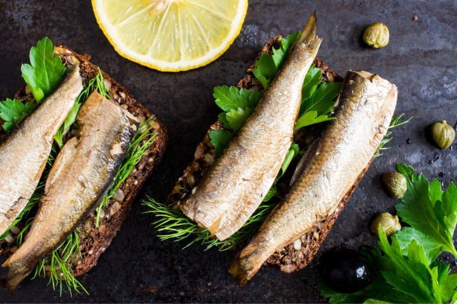 Mood boosting foods- sardines on brown breas with corriander and a slice of lemon